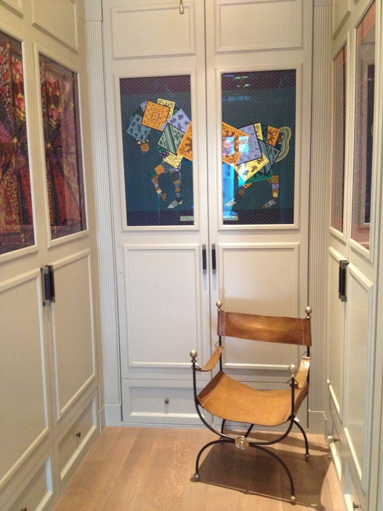 Hermes Scarves in glass front cabinets