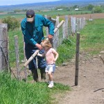 S. Lynn Loosli fence building with granddaughter Abbie Loosli