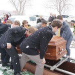 Moving the casket to the grave site
