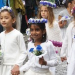 Children with flowers in their hair in the Lenzburg Jugendfest parade