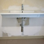 Duravit wall-mounted sink with Gessi faucet and Kohler P-trap